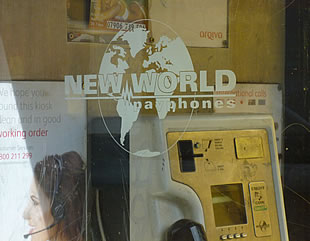 New World Payphones logo on payphone window